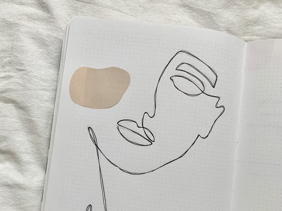 journal with line drawing of a women's face with beige rounds. caribu mommy mom mother's blog that gives parenting advice for kids, children, toddlers, preschoolers.
