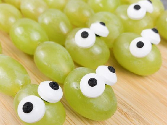 green grapes organized in lines on skewers with faux eyes made out of something edible. and against a pink background for this food entry. caribu mommy mom mother's blog that gives parenting advice for kids, children, toddlers, preschoolers.