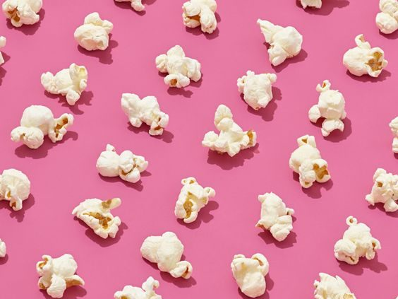 regular popcorn organized in lines and against a pink background for this food entry. caribu mommy mom mother's blog that gives parenting advice for kids, children, toddlers, preschoolers.