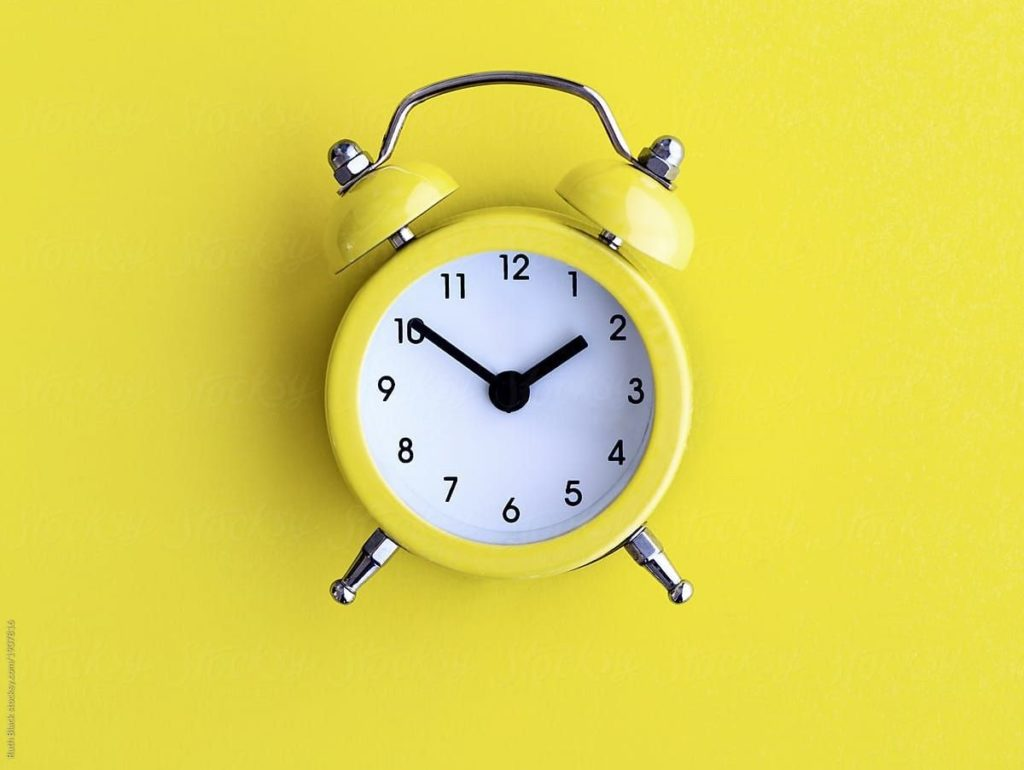 yellow vintage clock against a yellow background caribu mommy mom mother's blog that gives parenting advice for kids, children, toddlers, preschoolers.