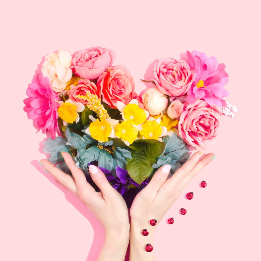 heart out of flowers with pink background caribu images tech app for kids and families
